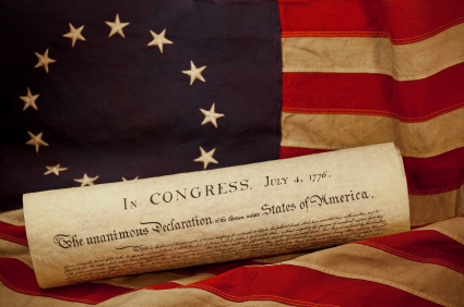 USA Declaration of Independence Lying on Grungy Betsy Ross Flag